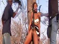 Submissive African girl gets tied to tree and fucked senseless by her masters