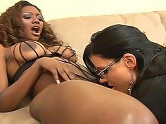 Two lesbians play with dildo and toying into the pussy