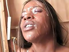 Ebony masturbates after facial